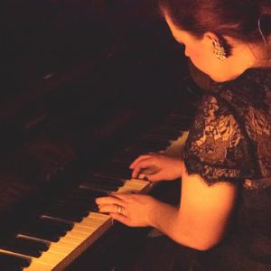 Emmy grand piano studio